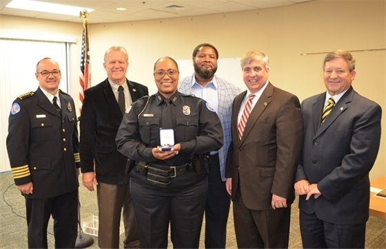 PPD officer of the year with Mayor Grover Robinson and other elected officials