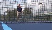 Brian Cooper on a tennis court