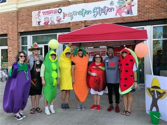 People dressed up in fruit and vegetable costumes