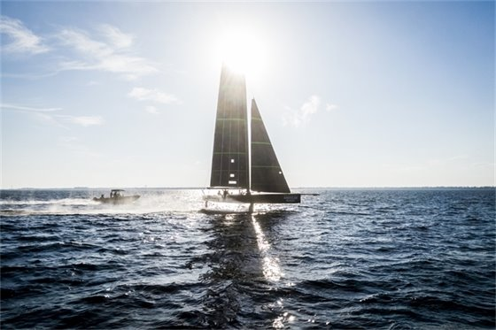 A sailboat in the sun on Pensacola Bay