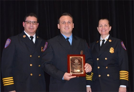 Firefighter of the year Joseph McCombs is recognized at the Pensacola Fire Department's annual awards ceremony