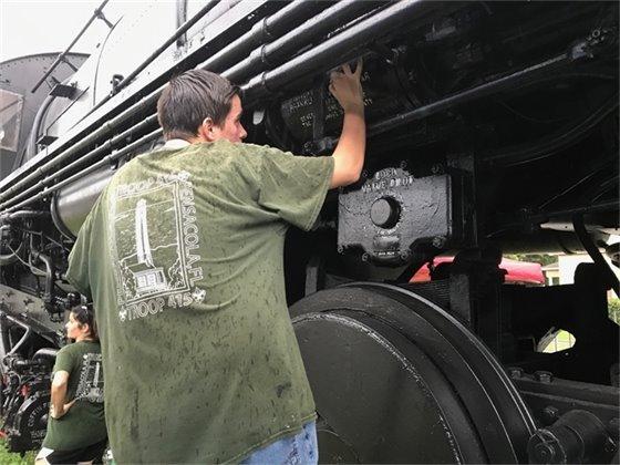 Zach Panici works on the historic Frisco 1355 locomotive on Garden Street Saturday, July 20