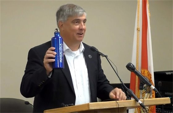 Mayor Grover Robinson holds up a new water bottle at his press conference Monday, June 10