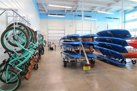 Paddleboards and bikes in storage