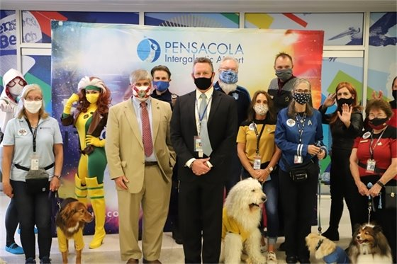 Mayor Grover Robinson with a group at Pensacola International Airport