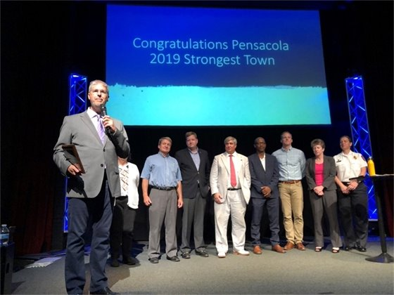 Strong Towns Founder Chuck Marohn presents Pensacola leaders with the 2019 Strongest Town award