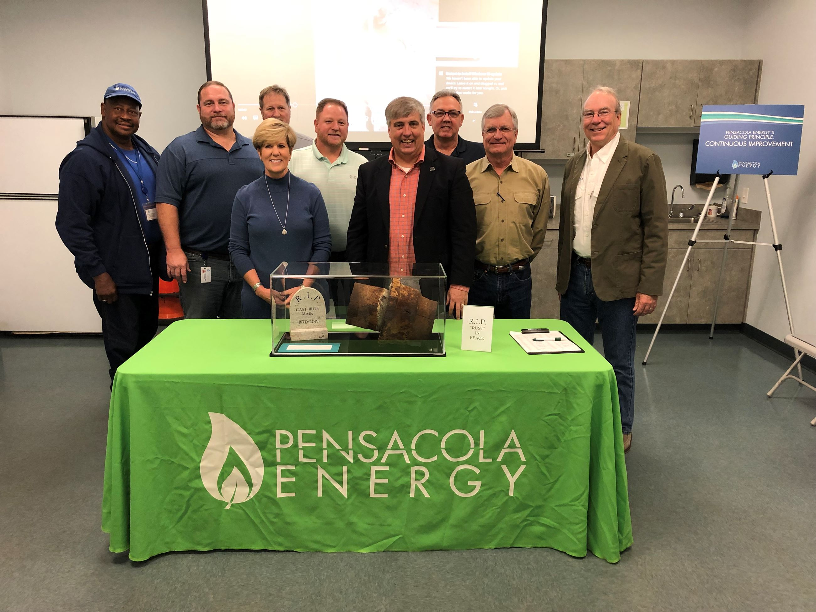 The mayor and Pensacola Energy staff pose for a group photo