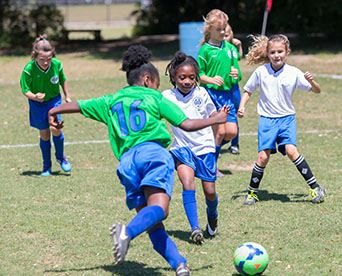 Pensacola Youth Soccer girls playing soccer game