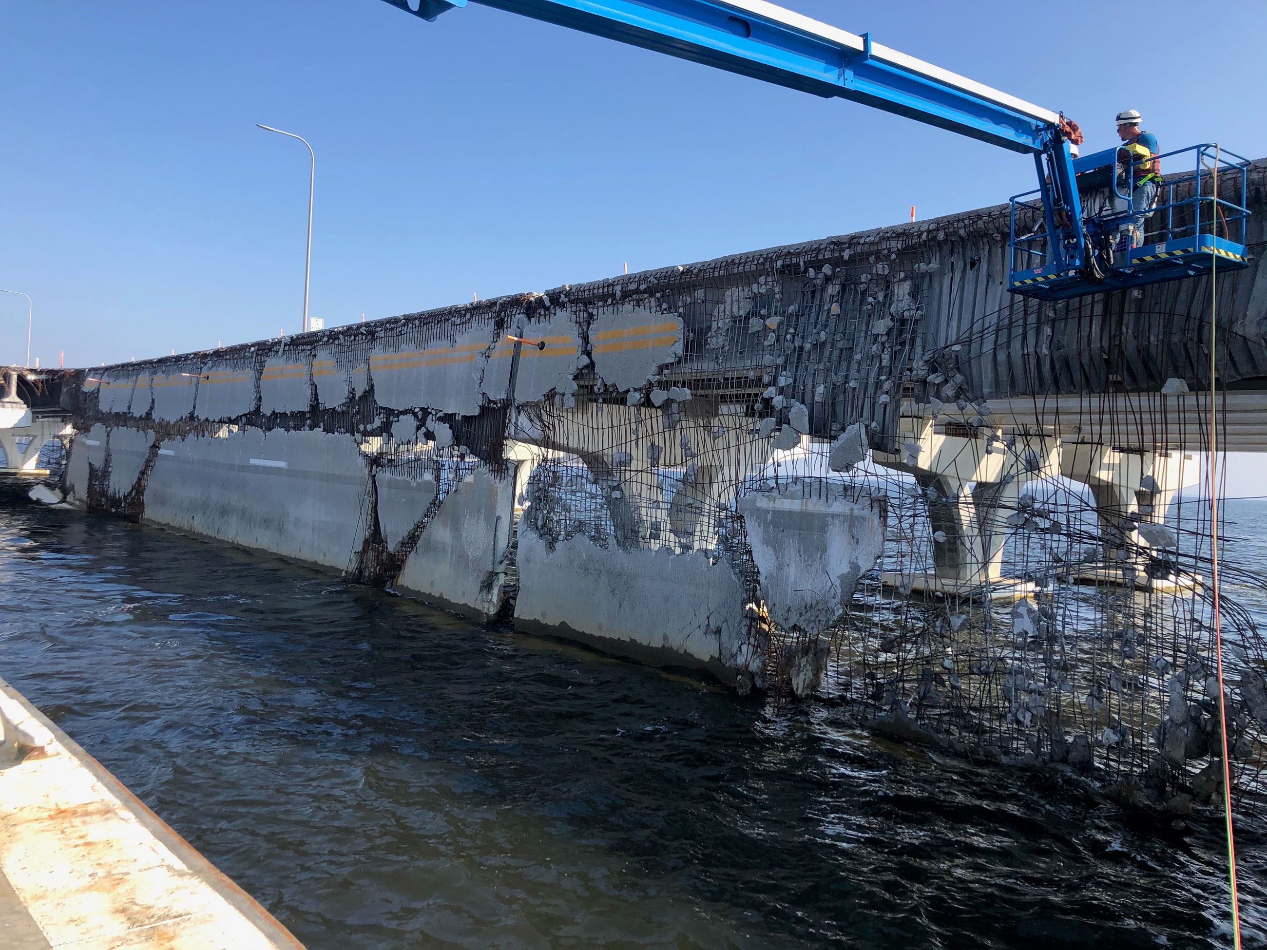 A section of the damaged Pensacola Bay Bridge being removed