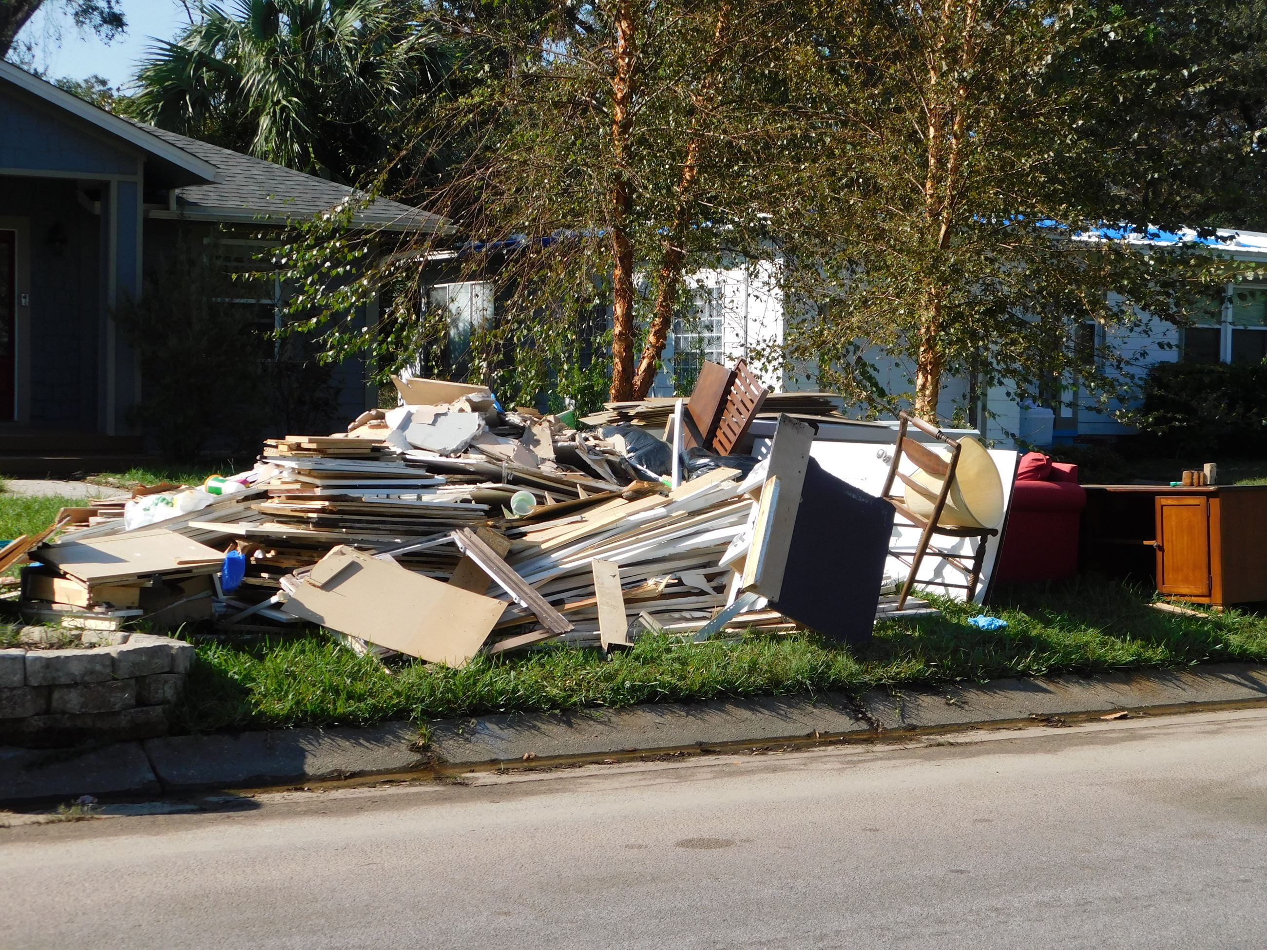 Hurricane Sally debris at the curb for pickup