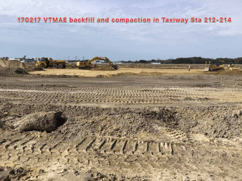 Backfill and compaction in Taxiway Sta 212-214.