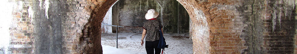 Visitor walking through Fort Pickens