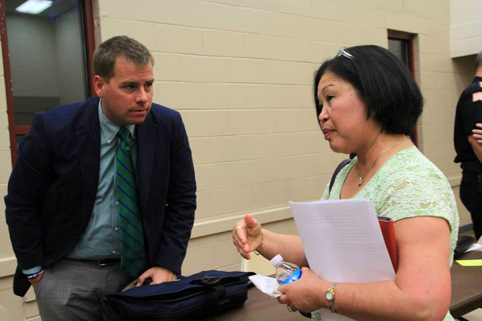 Councilman Terhaar with a citizen at a town hall meeting